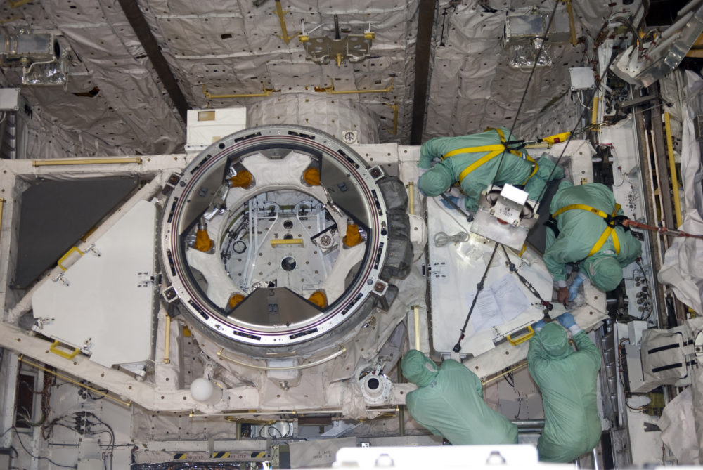 Installation of the tool stowage assembly in space shuttle Atlantis' payload bay. Photo credit: NASA/Jim Grossmann