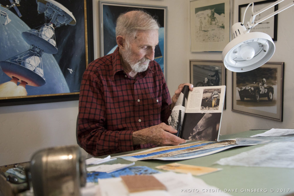 Pierre holds the issue of National Geographic with his illustration of Eagle seconds before landing. Photo: Dave Ginsberg 2017
