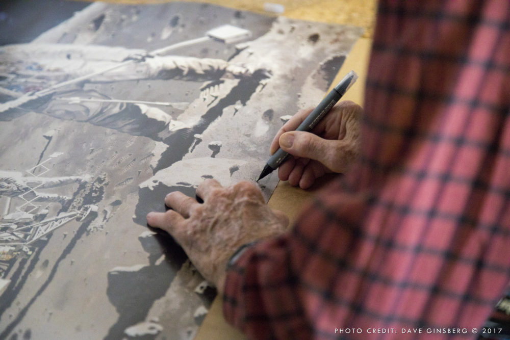 Pierre numbering (3 of 50) and personalizing my print of his Apollo 12 painting. Photo: Dave Ginsberg 2017
