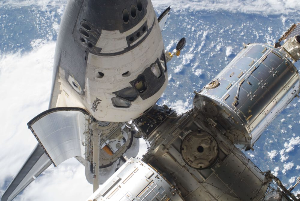 Space shuttle Atlantis's cabin and forward cargo bay and part of the International Space Station while the two spacecraft remain docked during STS-132 mission's Flight Day 4 extravehicular activity. Photo credit: NASA